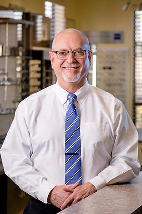 Dr. Curtiss Johnson