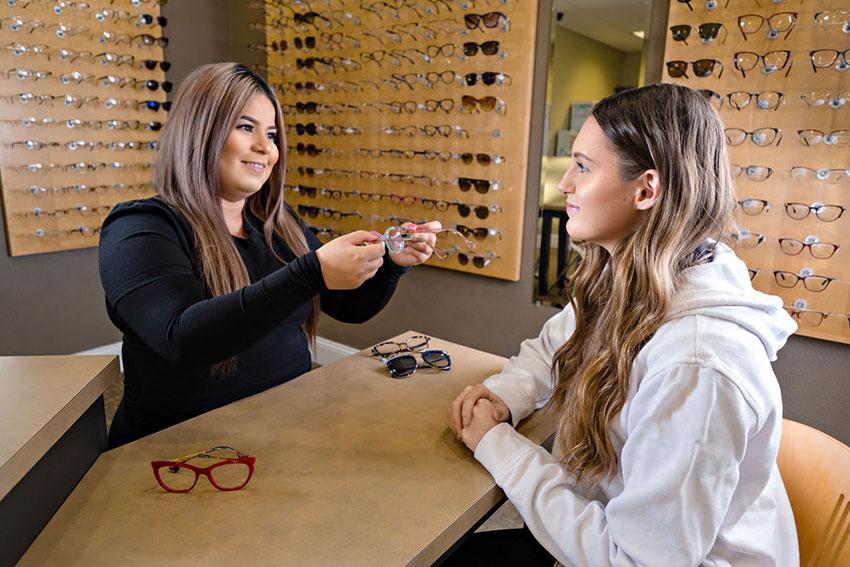 woman looking at eyewear